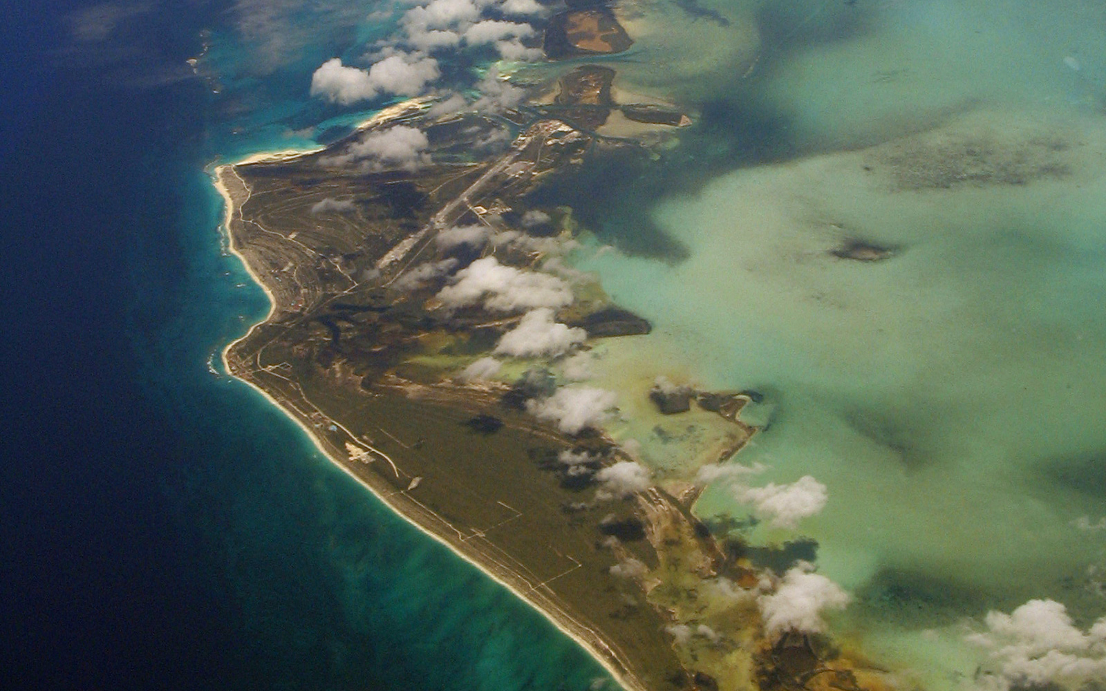 Aerial view of a Gulf Coast barrier island surrounded by blue-green ocean water
