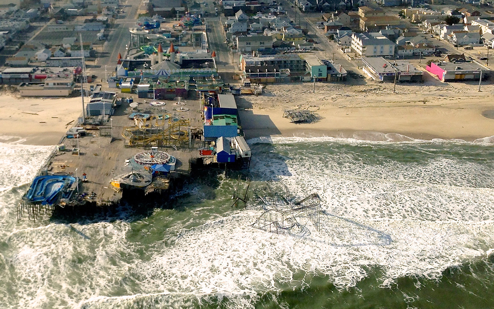 Aerial view of hurricane damage to a pier and other buildings along the U.S. coast