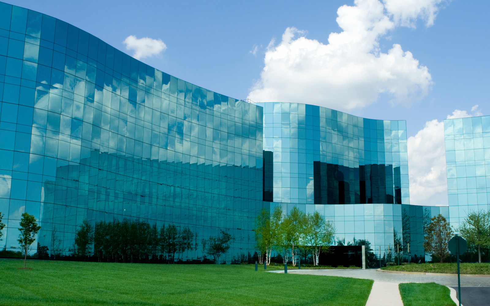 Exterior of large modern office building with tinted glass windows.