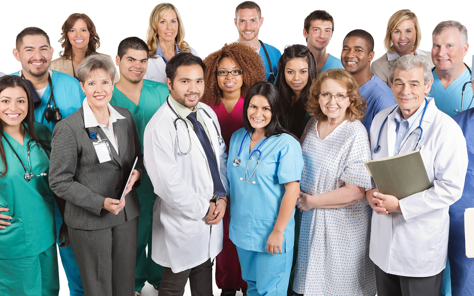 Over a dozen diverse smiling hospital staff and a patient standing together, all looking at the camera.