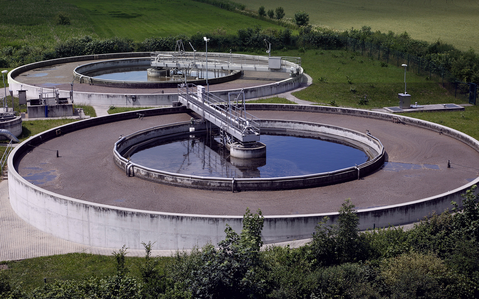 Aerial view of two large circular wastewater treatment tanks