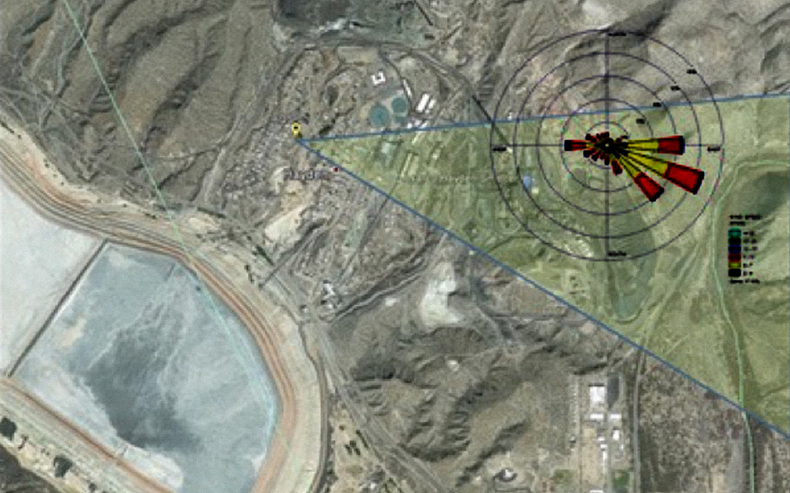 Example output of innovative risk-based method to identify facilities whose emissions may be exceeding permit limits. Output shows satellite view of an area overlaid with windrose showing pollution emissions from a point source.