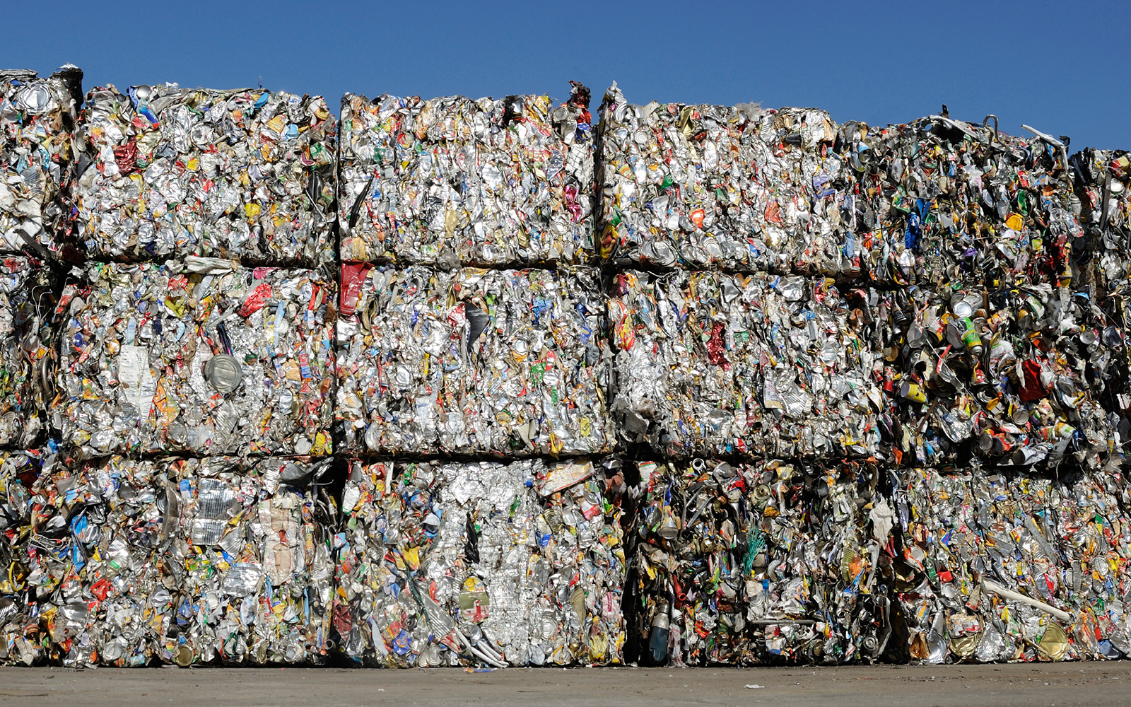 Large stacked bales of compacted trash