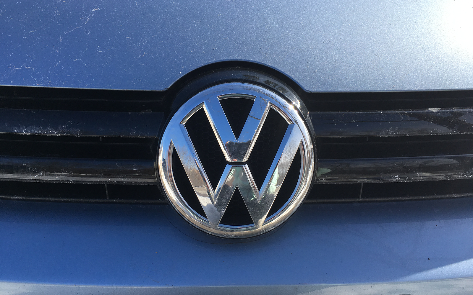 Photo of the Volkswagen emblem on a car