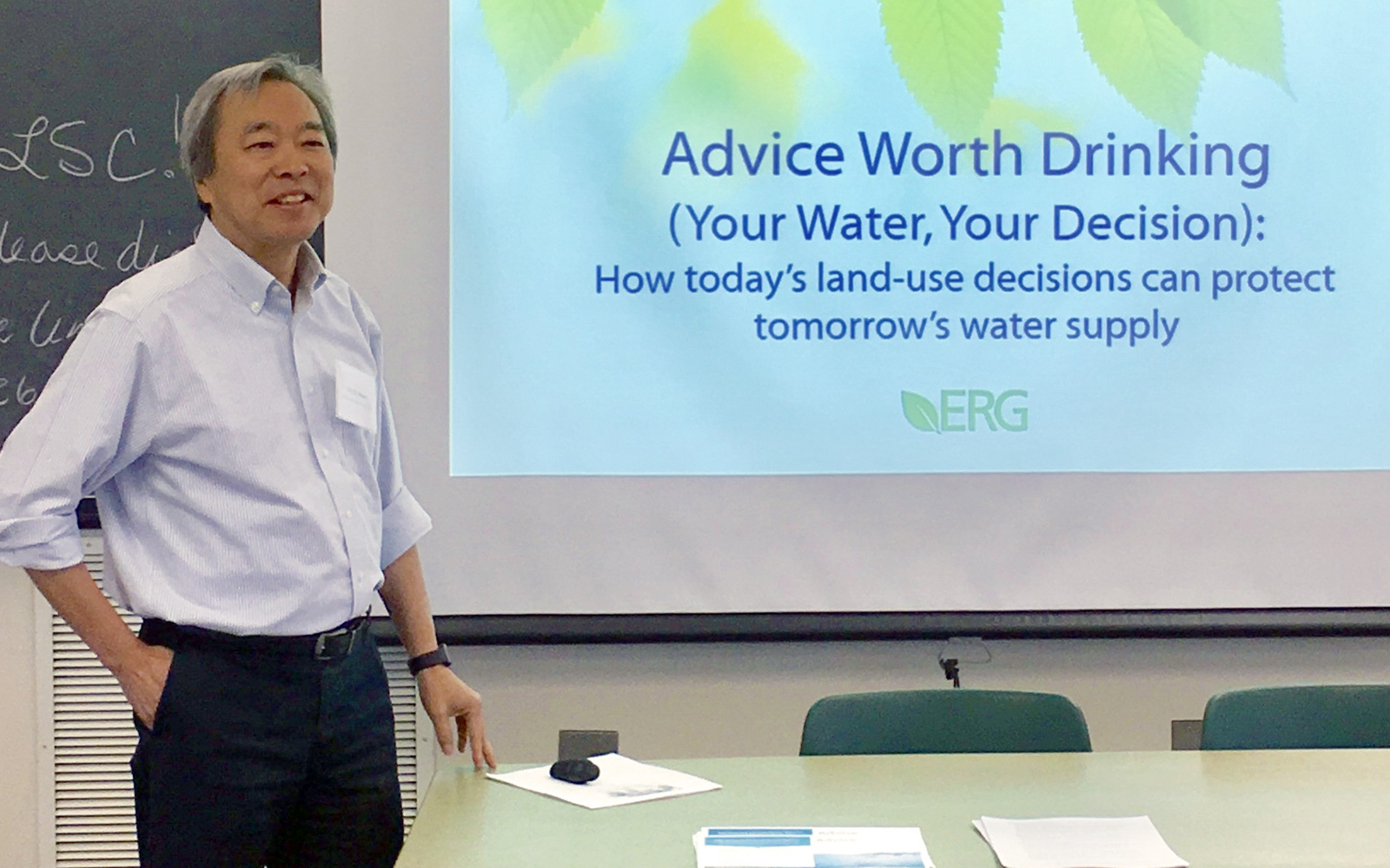 "Photo of ERG's Chi Ho Sham, making a presentation titled ""Advice Worth Drinking (Your Water, Your Decision): How today's land-use decisions can protect tomorrow's water supply"""
