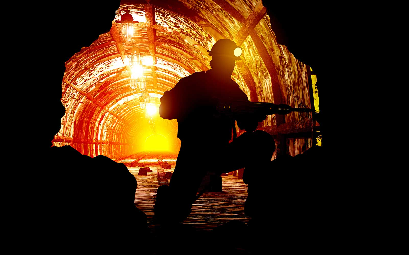 Miner drilling into rock face in a mine.
