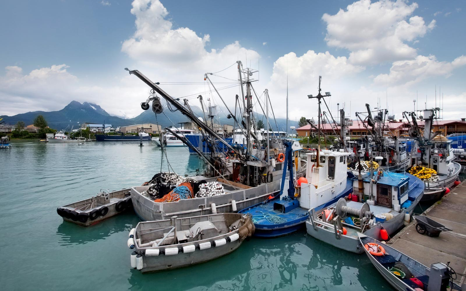 Commercial fishing boats moored in an Alaskan harbor