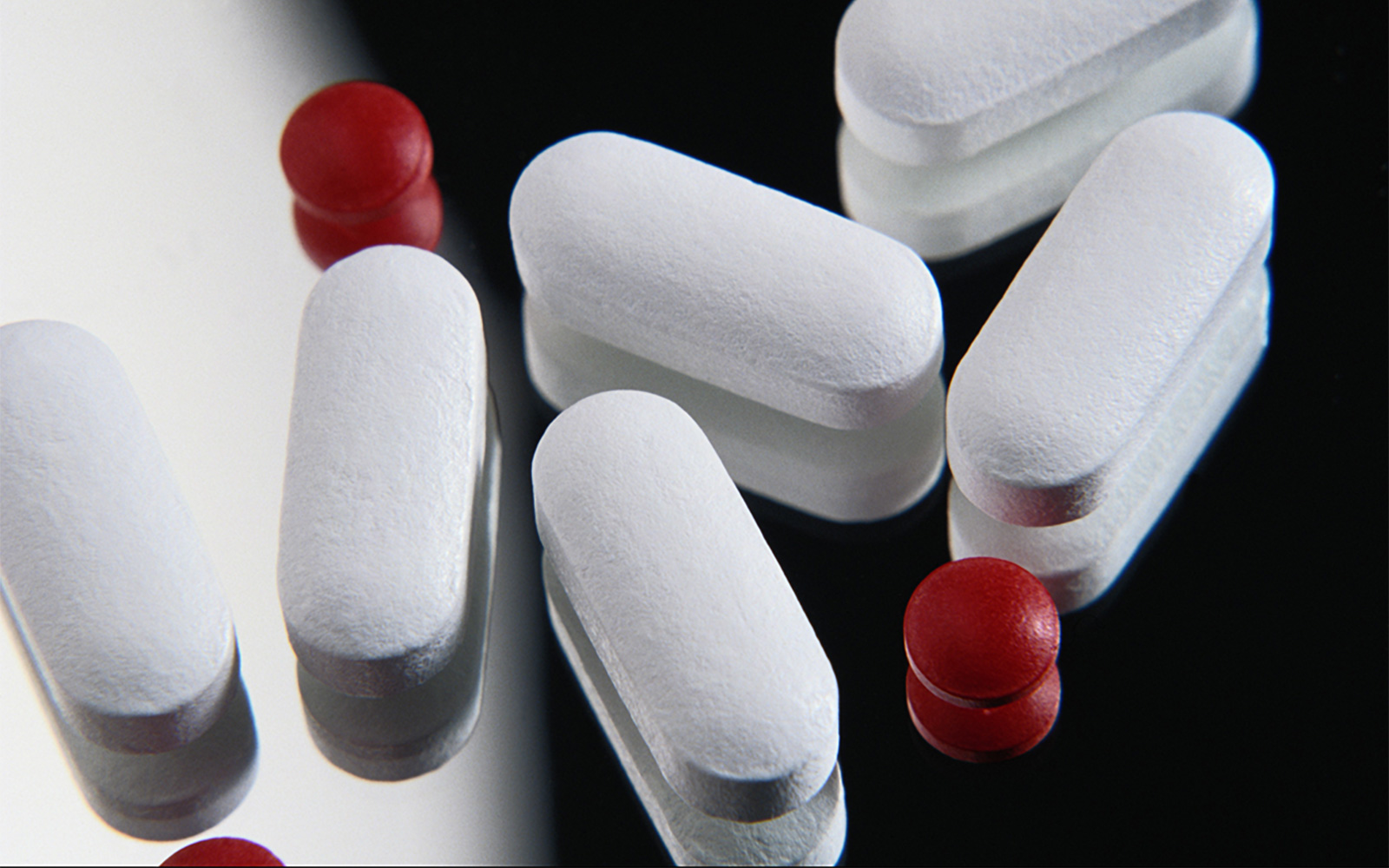Close-up of FDA-regulated medication pills on a mirror