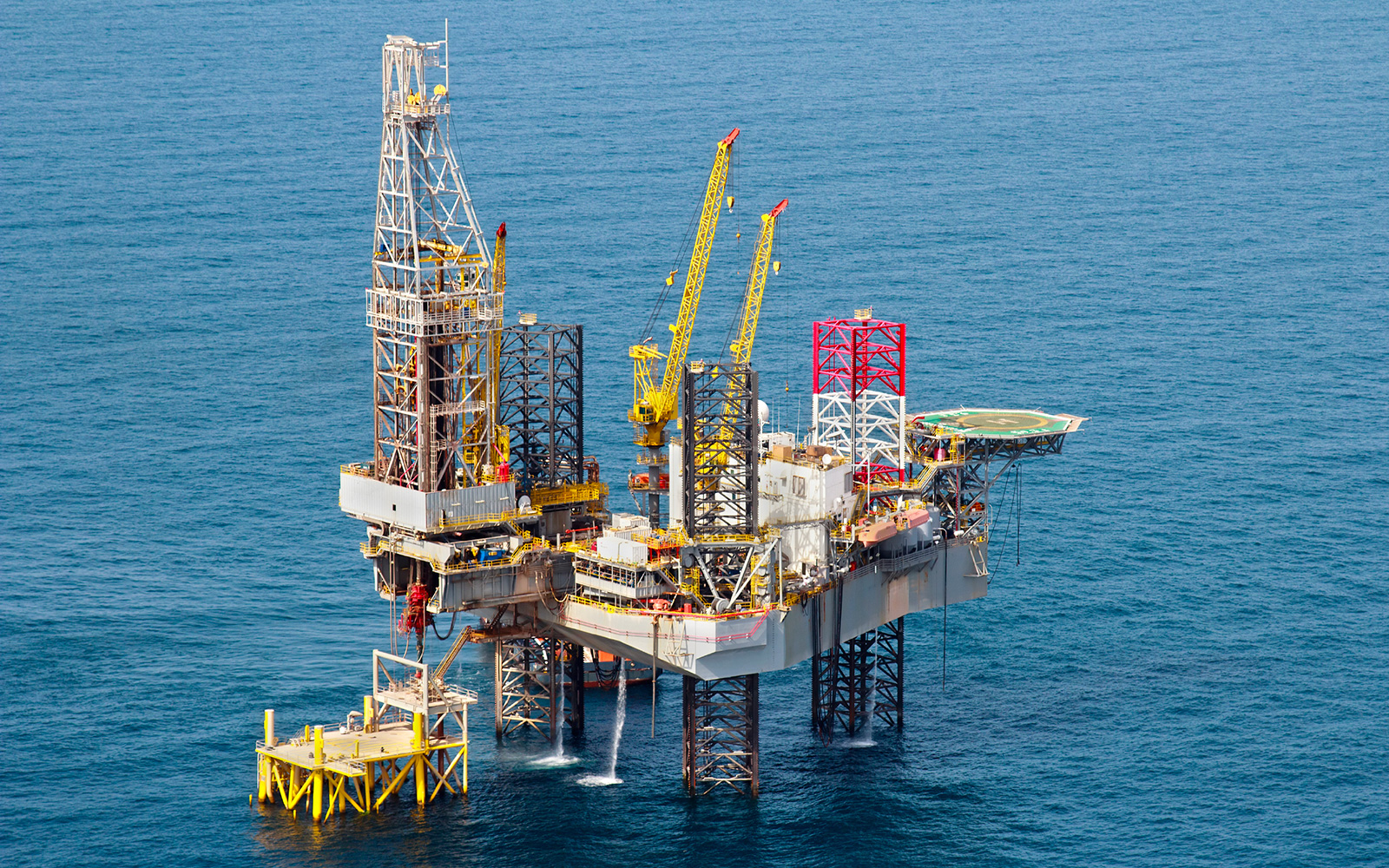 Aerial view of large oil offshore drilling platform surrounded by ocean